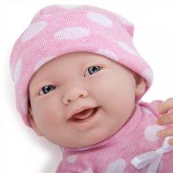 Dziewczynka w różowym ubranku w groszki